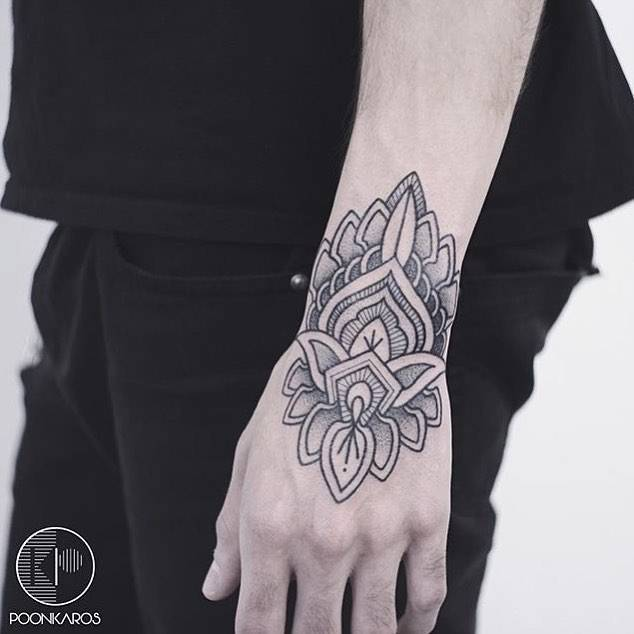 Henna-inspired tattoo on the wrist