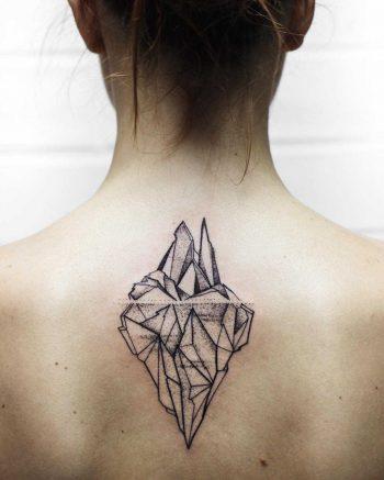 Iceberg tattoo on the upper back
