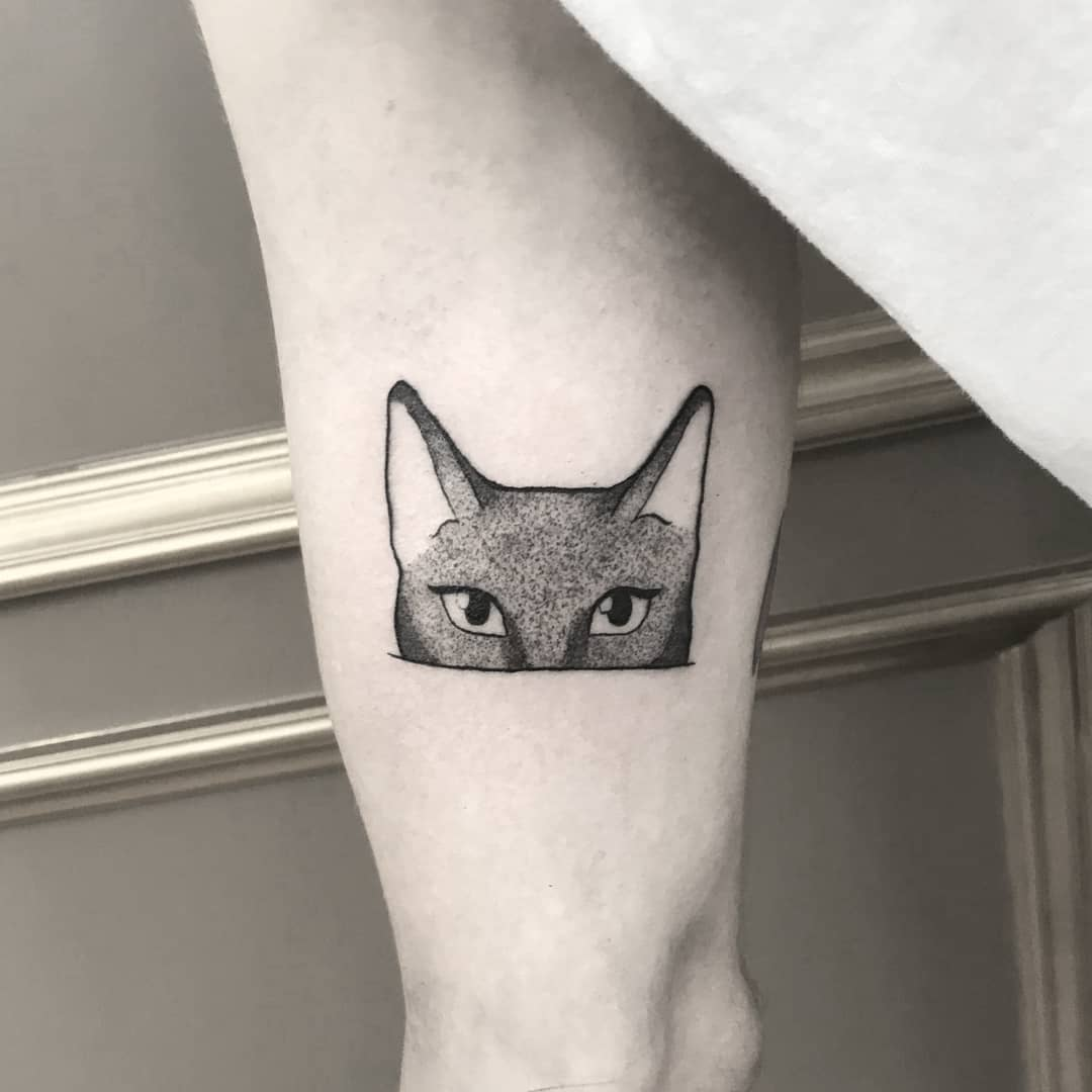 Kitten tattoo on the right arm