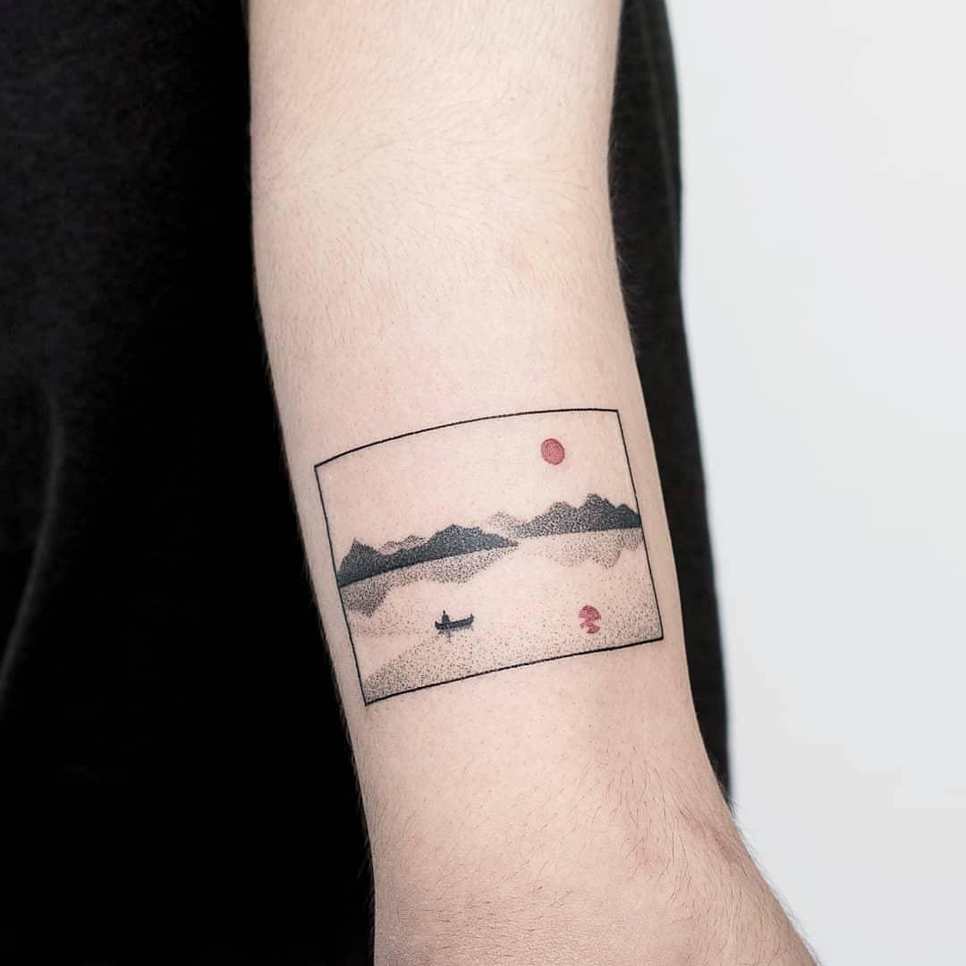 Landscape with a sunrise tattoo
