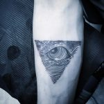 Linear triangle eye tattoo