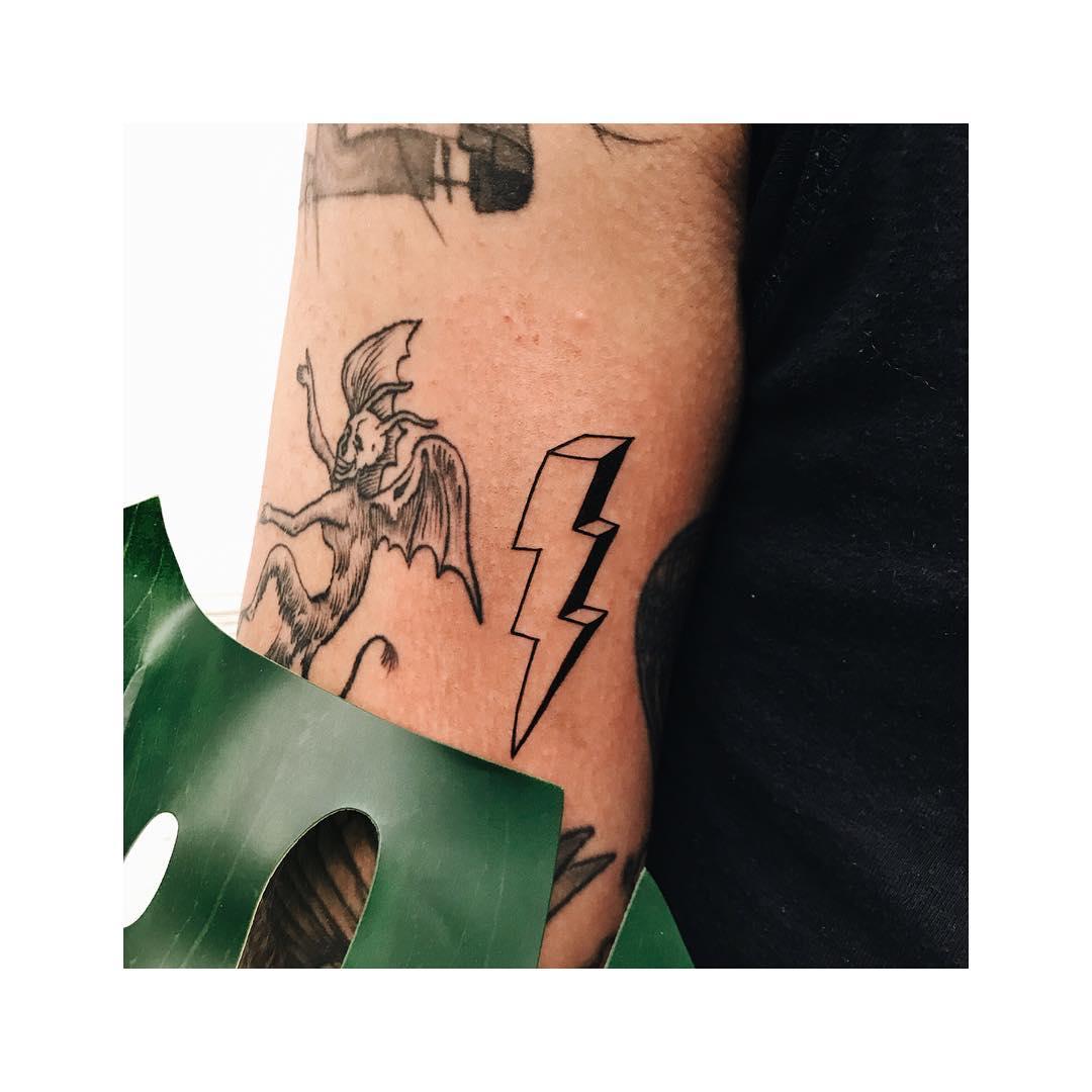 Little 3D lightning bolt tattoo