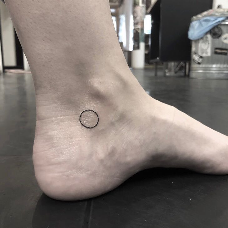 Little circle tattoo on the left ankle