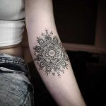 Mandala tattoo on the inner elbow