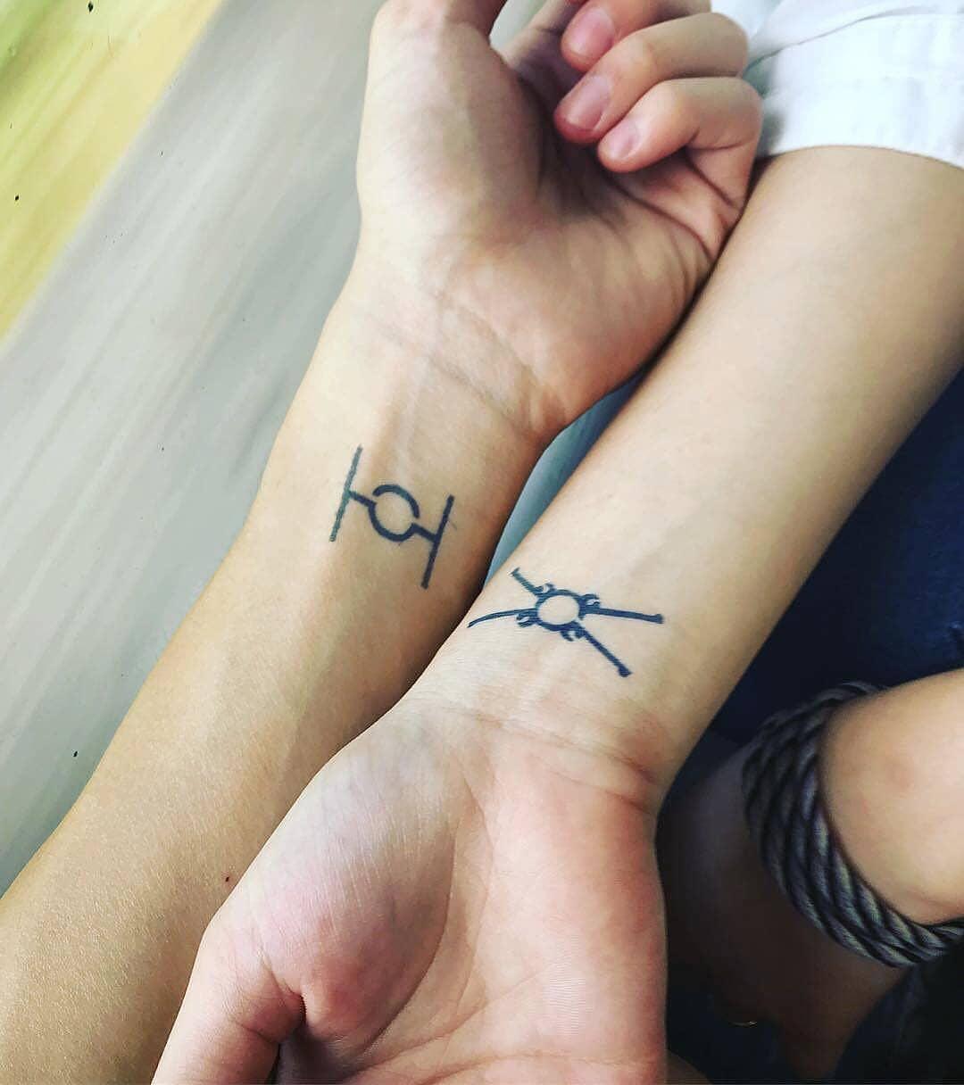 Matching Star War ship tattoos
