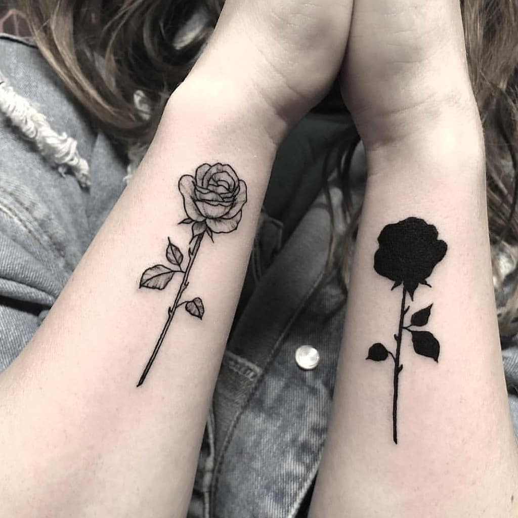Matching black and white roses