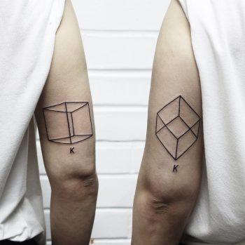 Matching cube tattoos inspired by Joseph Kosuth