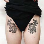 Matching flower tattoos on both hips