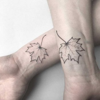 Matching maple leaf tattoos