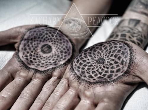 Matching ornament tattoos on both palms