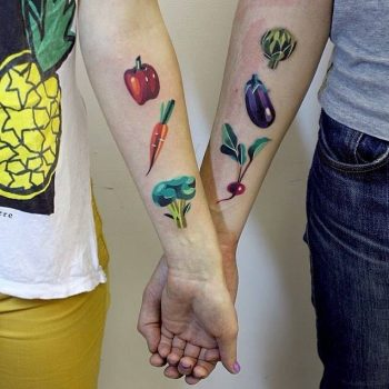 Matching vegetable tattoos for a couple