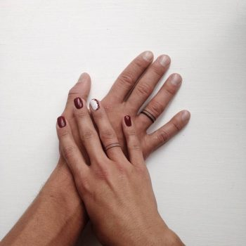 Matching wedding ring tattoos on fingers