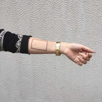 Minimalist rectangle tattoo on the wrist