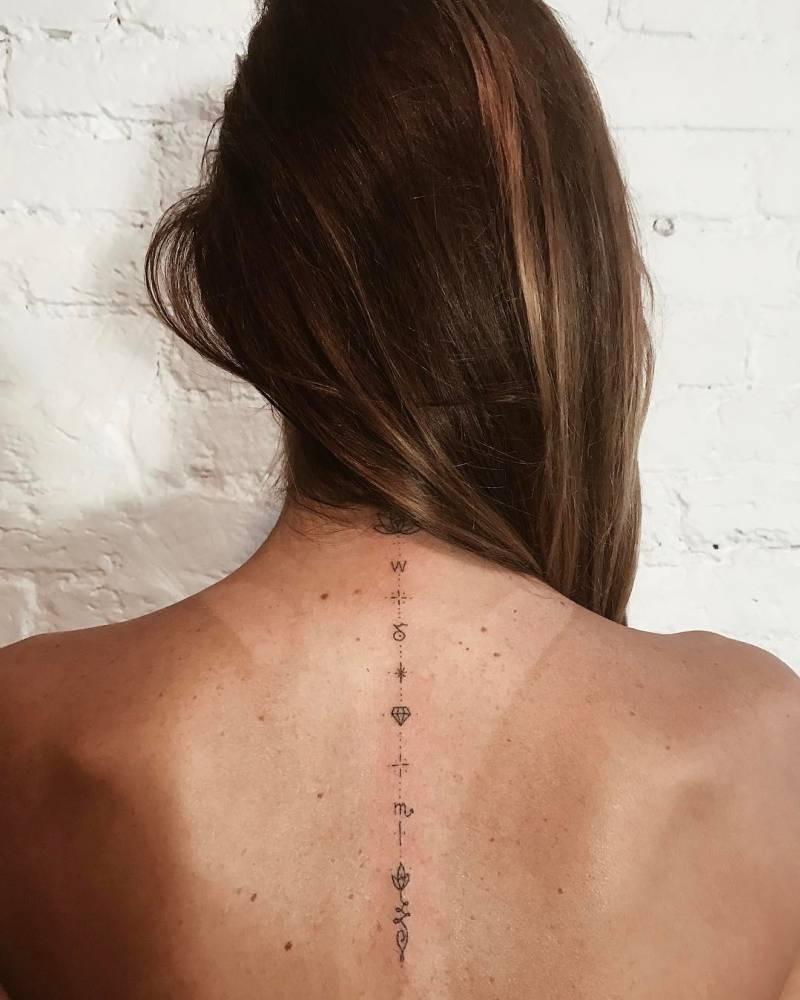 Minimalist tattoo on the back by Ann Pokes
