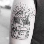 Mountains in a backpack tattoo