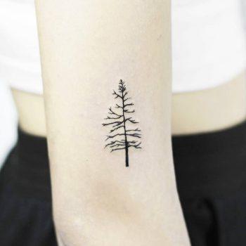 Naked Christmas tree tattoo