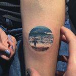 Ocean scenery tattoo by Eva Krbdk