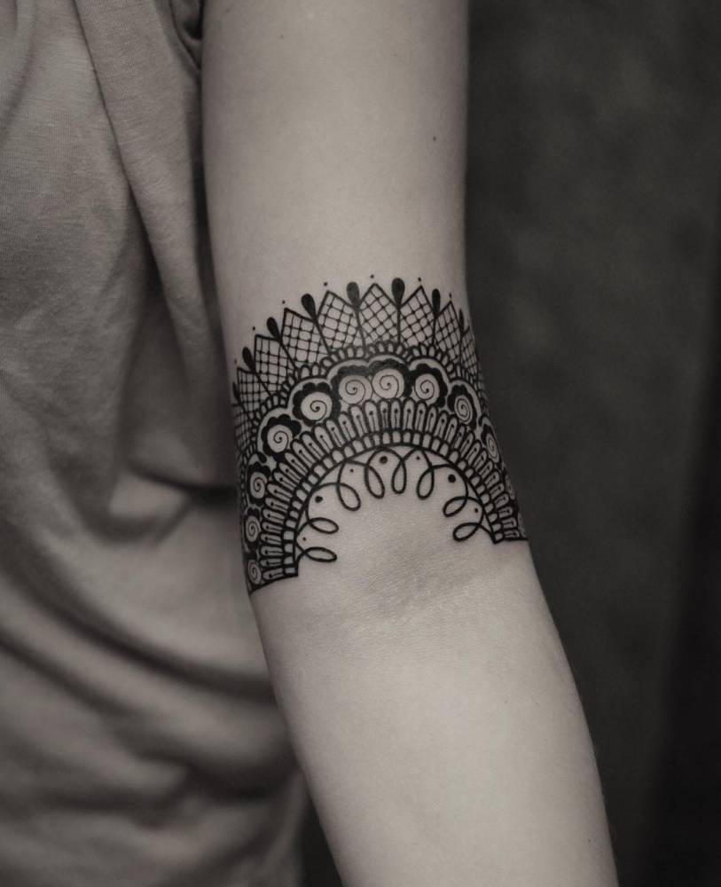 Ornamental lace tattoo on the arm