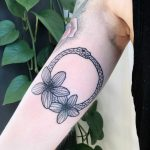 Ouroboros and flowers on the right arm