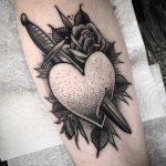 Pierced heart tattoo by James Butler