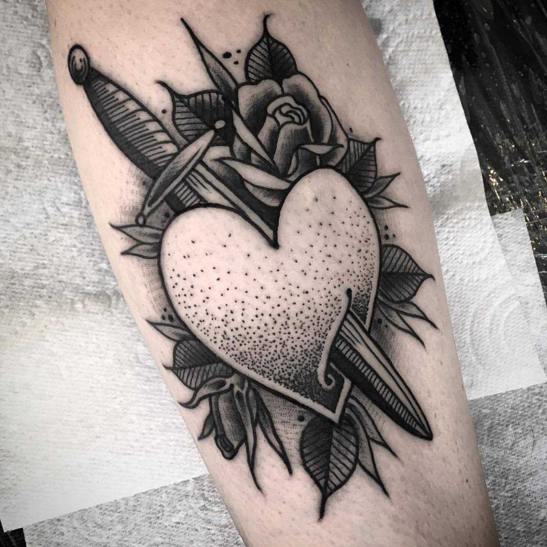 Pierced heart tattoo by James Butler