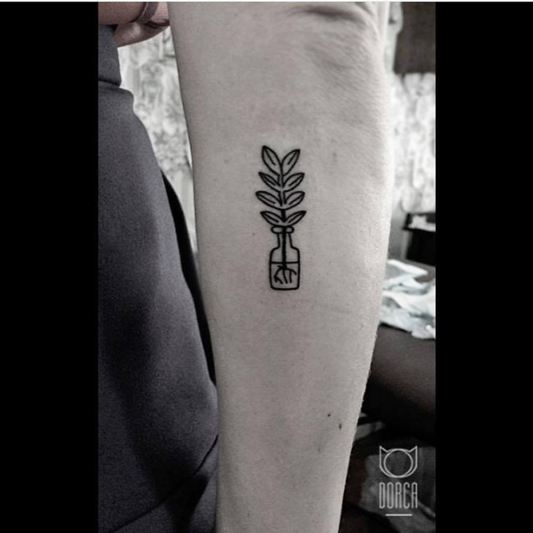Plant in a bottle tattoo by dorca borca