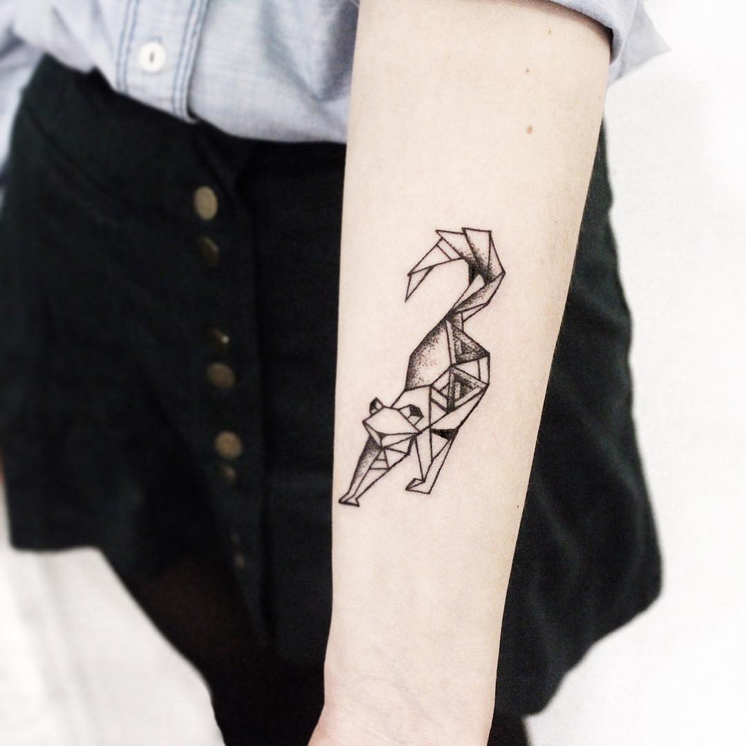 Polygonal cat tattoo on the forearm