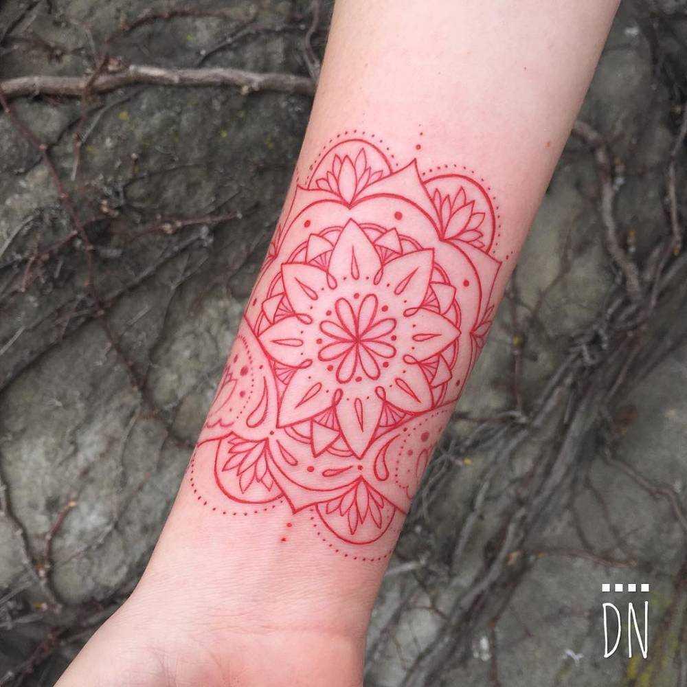 Red infinity mandala tattoo