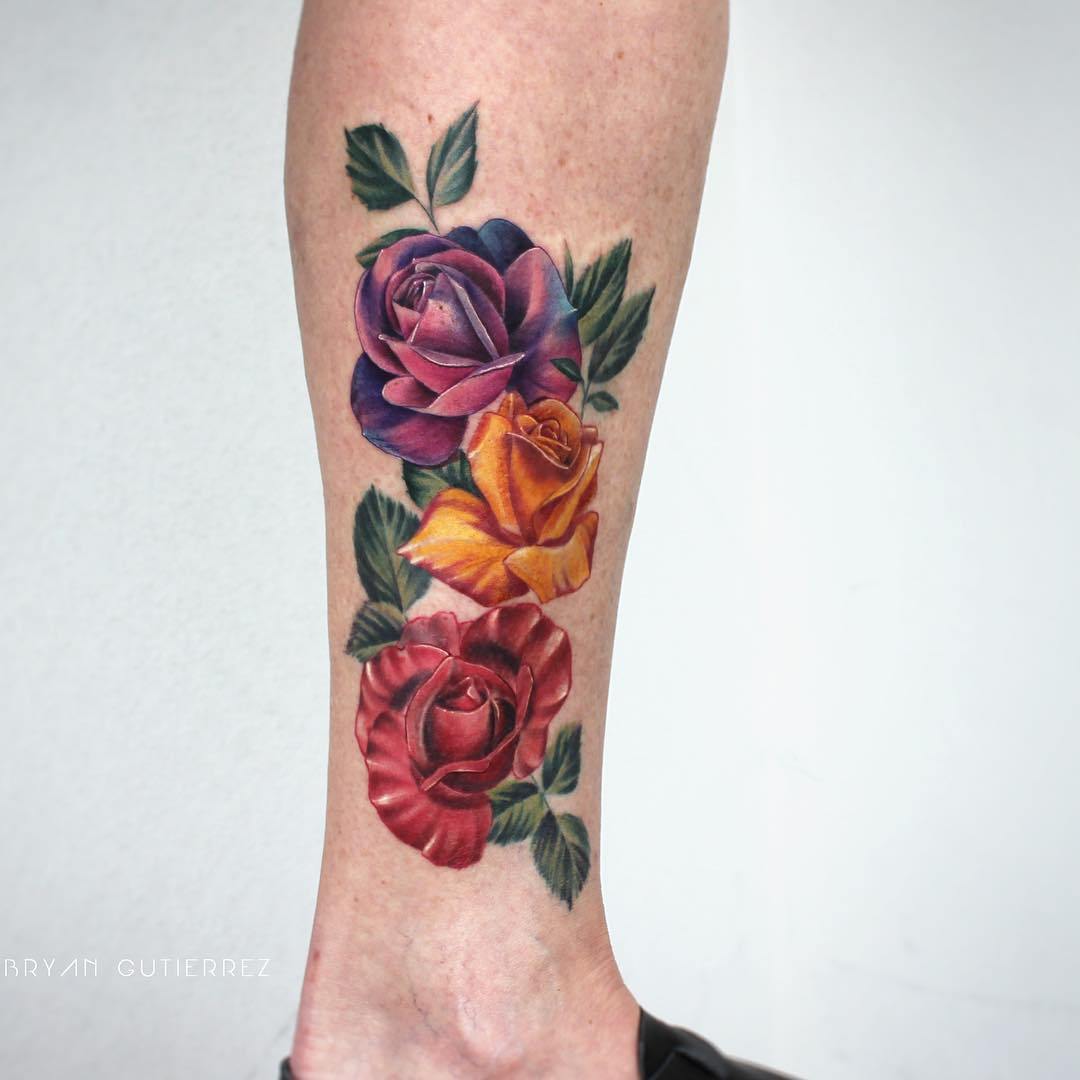 Red, yellow, and purple rose tattoo