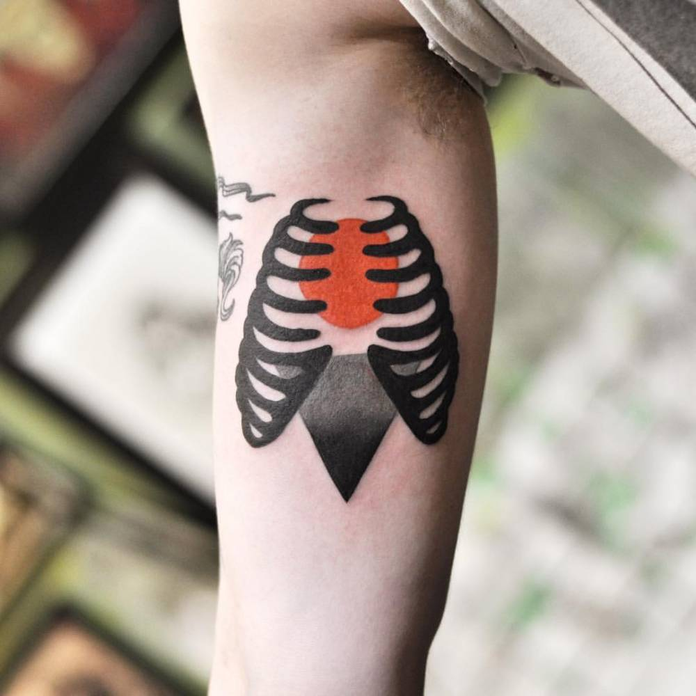 Rib cage tattoo on the arm