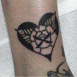 Rose in a heart tattoo by Jeroen Van Dijk