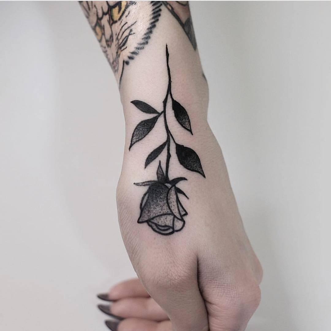 Rose on the hand by Jonas Ribeiro