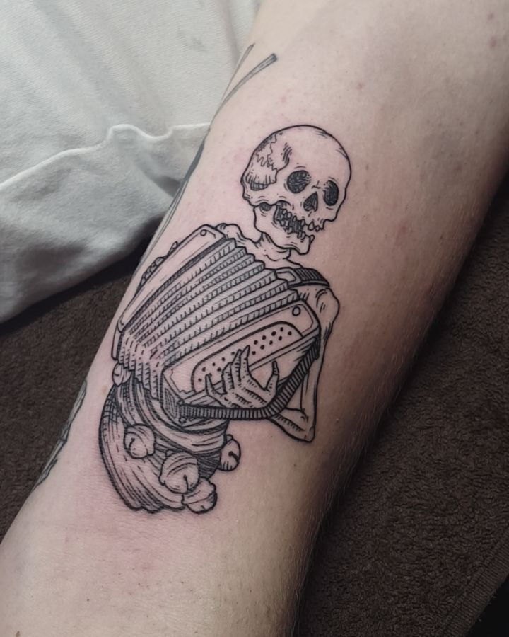 Skeleton accordion player tattoo