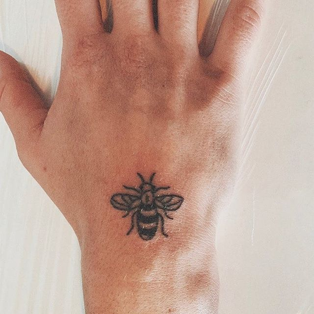 Small bee on the hand