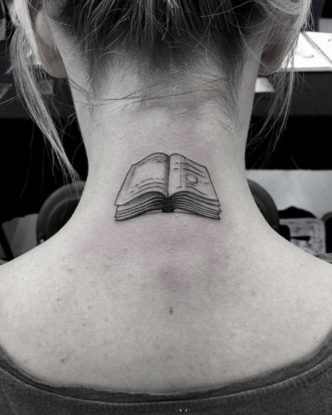 Small book tattoo on the neck