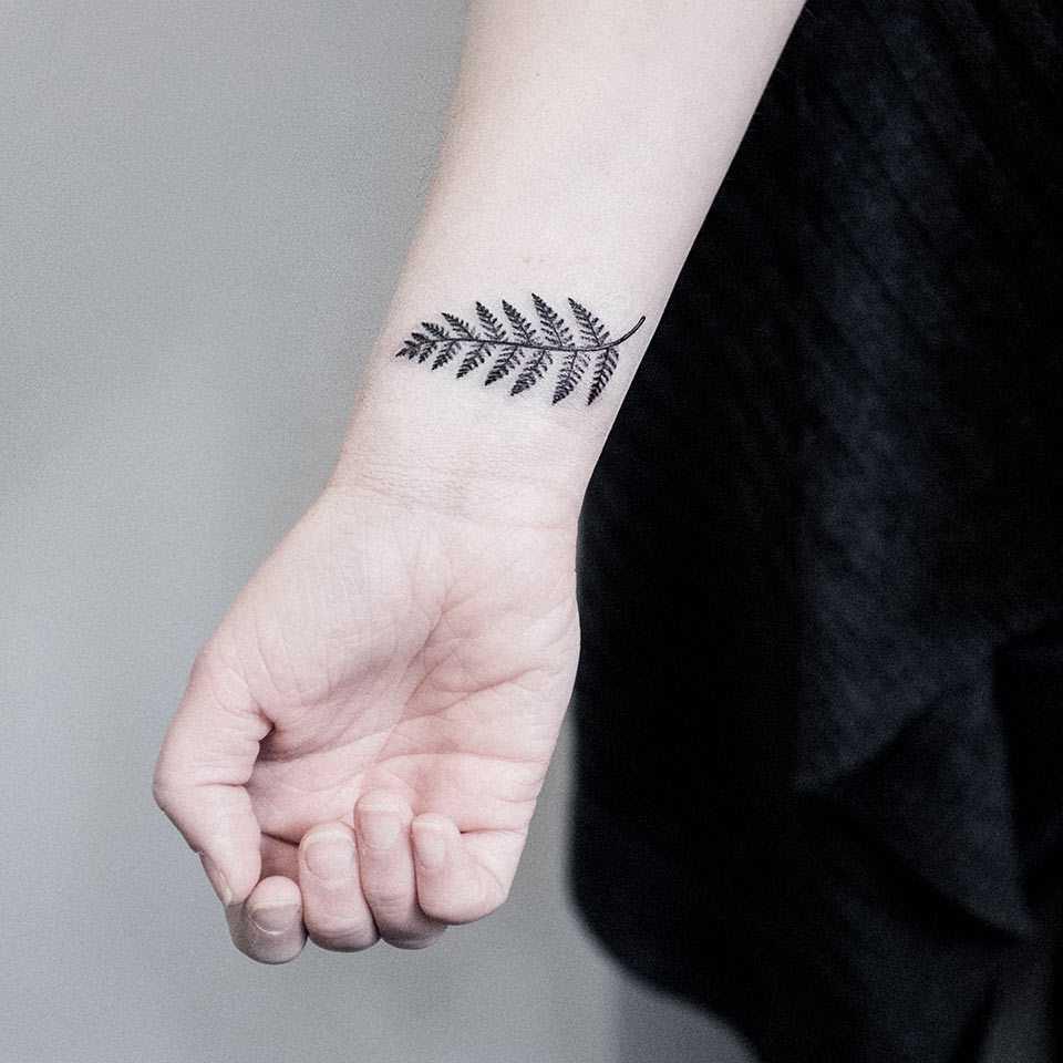 Small fern leaf tattoo on the wrist