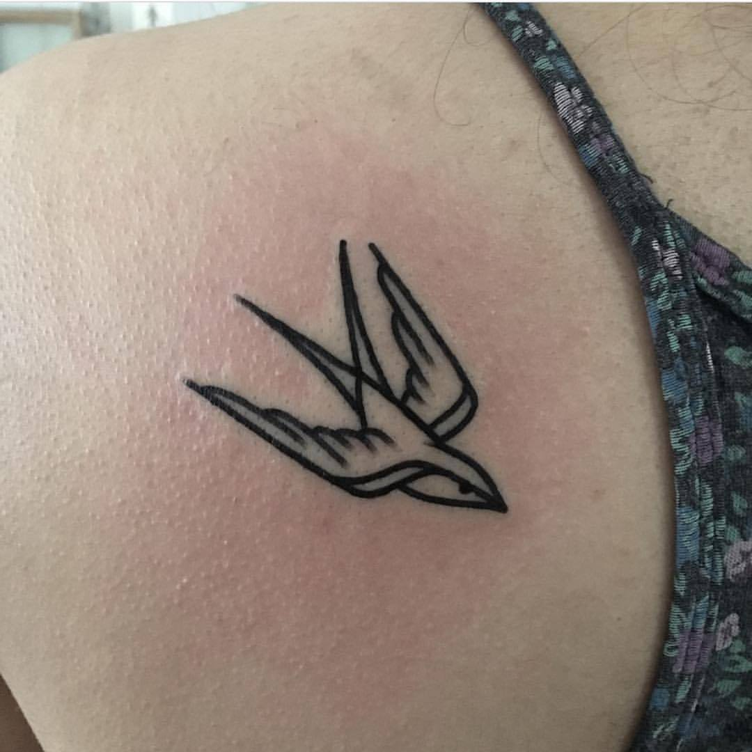 Small swallow tattoo by Jeroen Van Dijk