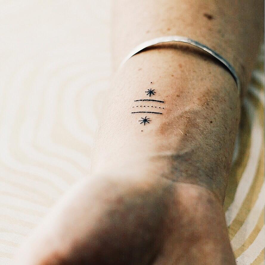 Stick and poke tattoo by Kate Kalula
