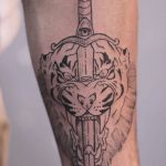 Tiger and sword tattoo by kyle. kyo koko