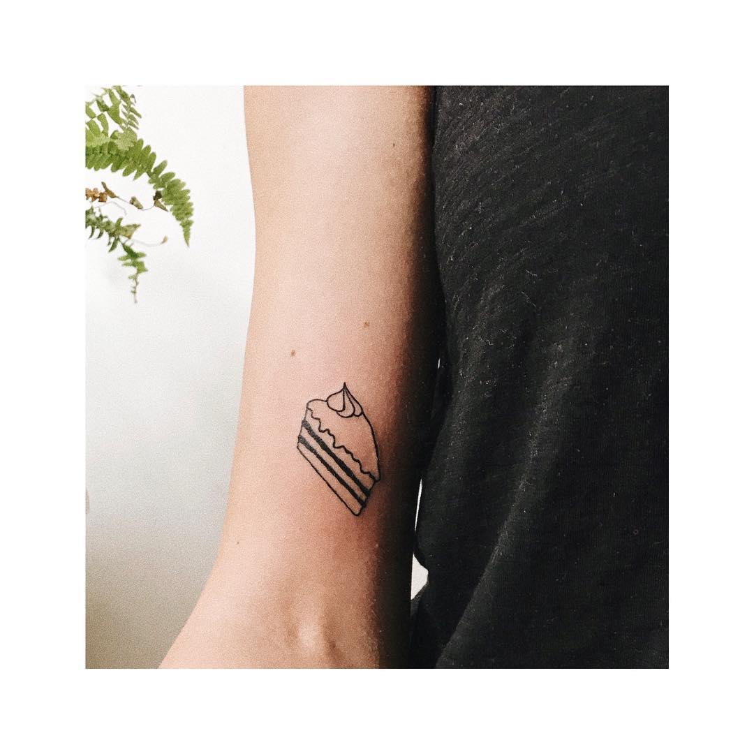 Tiny piece of cake tattoo