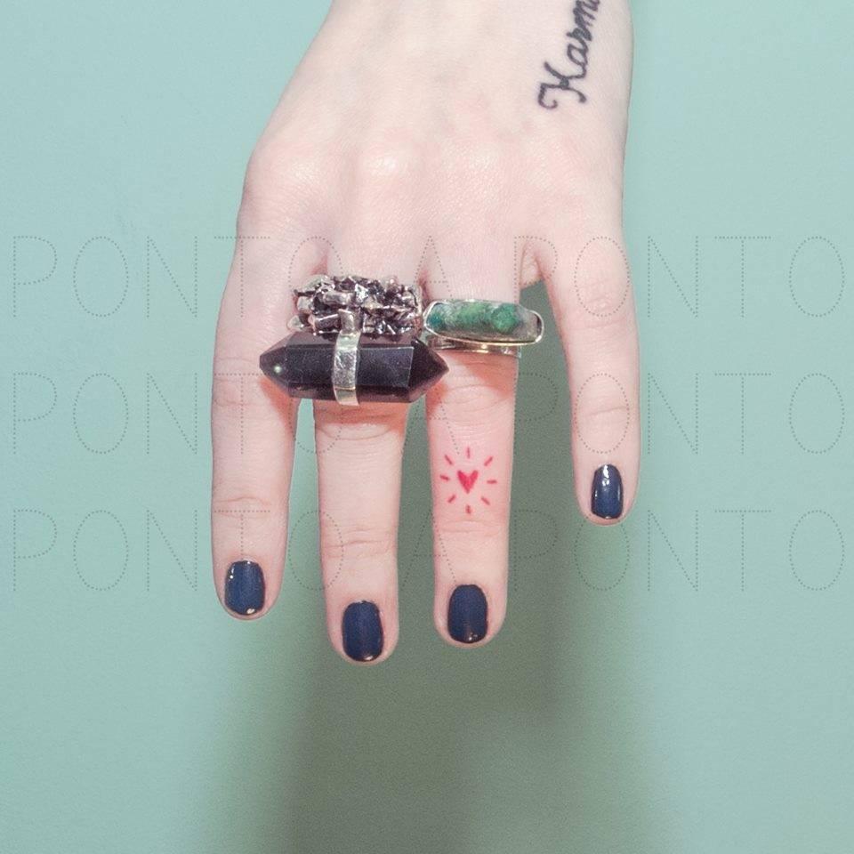 Tiny red hand-poked heart
