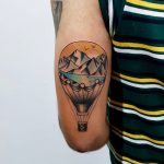 Traditional style hot air balloon and landscape tattoo