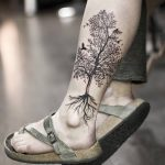 Tree tattoo on the left calf by Stella