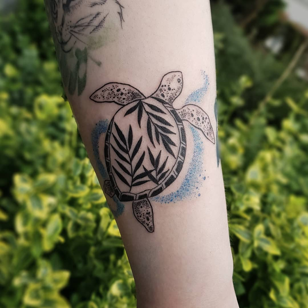 Turtle tattoo on the forearm