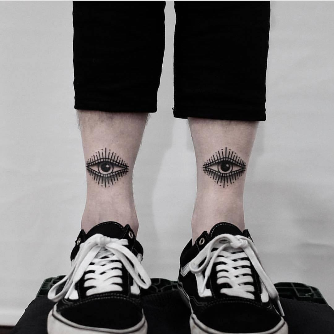 Two eyes on both shins by Jonas Ribeiro