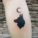 Wolf and crescent moon tattoo