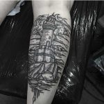Woodcut style lighthouse tattoo by Kola Hari