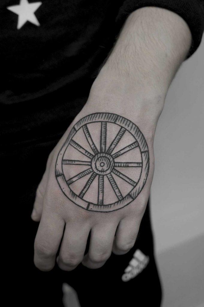 Wooden wheel tattoo