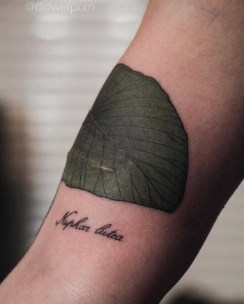 Yellow water lily leaf tattoo