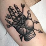 A hand with arrows tattoo